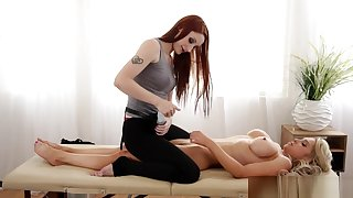 Redhead Les masseuse pussylicking around client